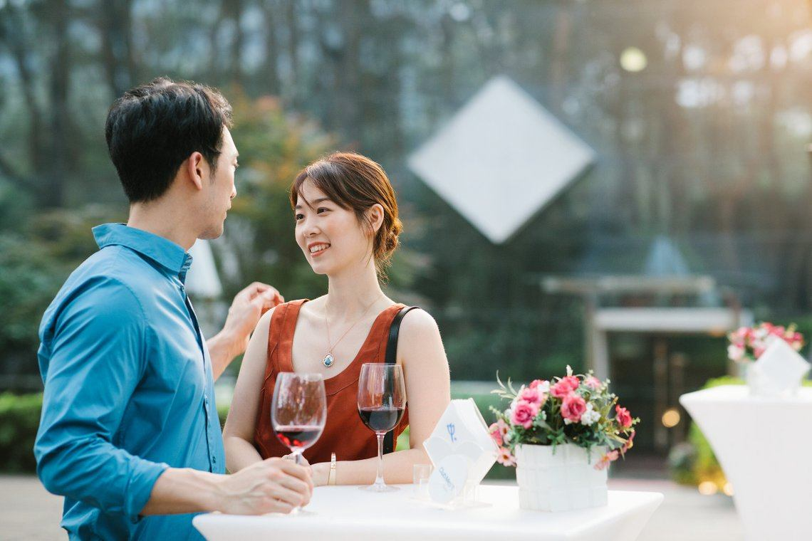 Romantic couple drinking Wine at Club Med Guilin