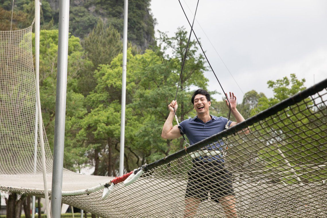 Man smiling after trying trapeze at Club Med Guilin